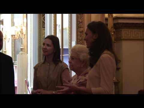 The Queen and The Duchess of Cambridge view the Royal Wedding Dress Exhibition