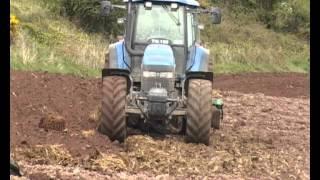 getlinkyoutube.com-New Holland TM155 ploughing the headlands