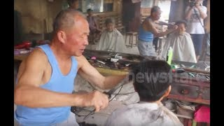 getlinkyoutube.com-Chinese barber practising the rare art of cutting hair with hot tongs