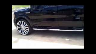 Ford F150 on 28s with 3 12 inch subs custom box and suede headliner