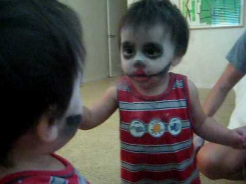 Baby Scares himself in the mirror