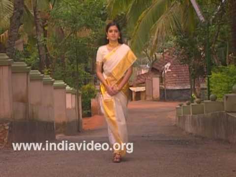 Kasavu sari Costume Kerala Woman