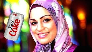 Muslim Woman Denied Can Of Coke On Plane Because She Could Use It As A Weapon width=