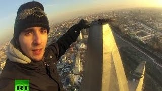 getlinkyoutube.com-Nerves of Steel: Daredevil climber conquers Stalin Skyscrapers
