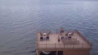 Amazing 80yd throw and catch off dock