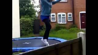 (Funny) Girl jumps over fence from trampoline