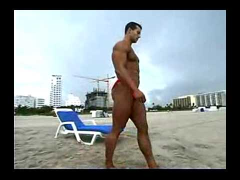 Adonis bodybuilder at beach