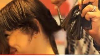 haircut on long hair  to a pixie