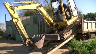 getlinkyoutube.com-Unloading Digger & Full set of buckets from lorry HD