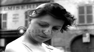 getlinkyoutube.com-People cut the hair of French women collaborators in the village square of Nemour...HD Stock Footage