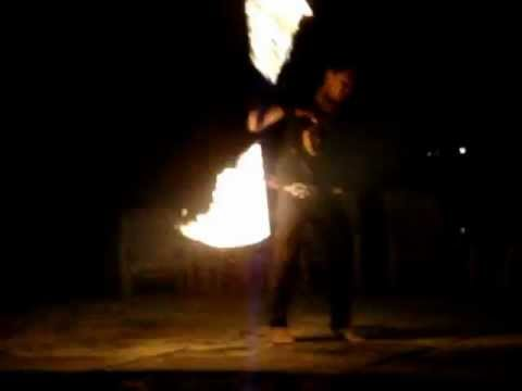 Thai man swinging fire