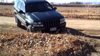 """getlinkyoutube.com-New Rough Country Jeep WJ 4"""" Lift with 32"""" BFG Mud Terrains"""