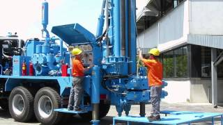 getlinkyoutube.com-M.I.45 water wells drilling rig, 45 tons pull-back and carousel pipe loader