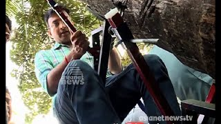 getlinkyoutube.com-New model of coconut tree climbing machine, invented by brothers