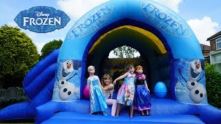 getlinkyoutube.com-Frozen Elsa and Anna Life Size Dolls Playing Outside   Giant Inflatable Frozen Bouncy House