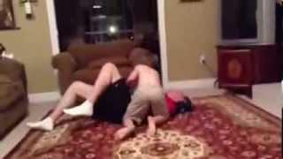 getlinkyoutube.com-son works dad over in living room wrestling match.