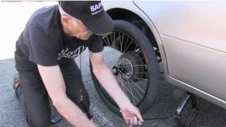 getlinkyoutube.com-Bicycle Wheel On Car