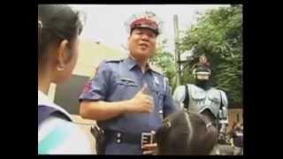Robert Fabregas as Mamang Pulis with Officer BOH (Badge Of Honor)