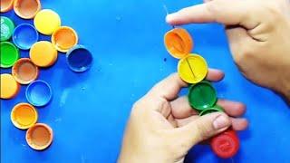 getlinkyoutube.com-MANUALIDADES - Como hacer canasta con tapas de botellas recicladas - RECICLAJE
