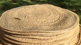 getlinkyoutube.com-Making White Injera, Mass production using Two different Mitads