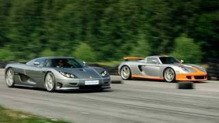 getlinkyoutube.com-Porsche Carrera GT vs Koenigsegg CCR Evolution x 2 Races to 200 mph / 320 km/h