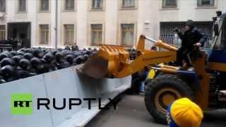 getlinkyoutube.com-Ukraine: Protesters throw flares as a digger is driven through police barricade