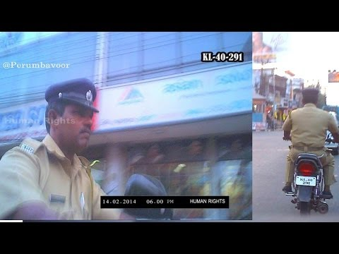 PERUMBAVOOR POLICE OFFICER IS USING TWO WHEELER WITHOUT HELMET @ SIGNAL