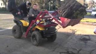 Ground hog atv front loader on polaris sportsman 500 lifting 700lb round of wet cherry