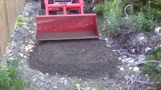 getlinkyoutube.com-Kubota BX tractor road and fence building SW corner