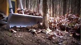 getlinkyoutube.com-RC Dozer Pushing over trees with KG blade