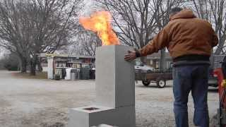 getlinkyoutube.com-Burning out the core on a new Rocket Stove