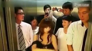 Chinese girl remove his clothes in elevator Funny Video