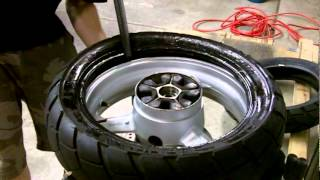 getlinkyoutube.com-No-Mar Classic Model Tire Changer in use