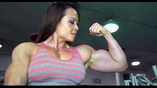 Big and Strong Muscle Woman Gym workout and Posing