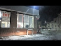 INSIDE A GHETTO GAS STATION AT NIGHT ON DETROITS EAST SIDE