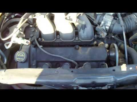 Где в Mazda Трибьют катушка зажигания