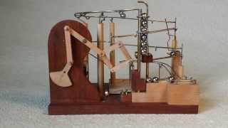 getlinkyoutube.com-Marble Machine using Peaucellier's rotary to linear linkage machanism
