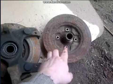 Где у Мазда Premacy передние тормозные диски