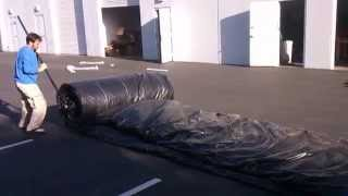 getlinkyoutube.com-Watch wimpy man roll up 850lbs inflatable slide with inflatable rolling machine