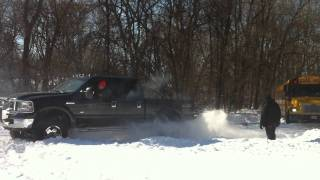 My f250 pulls school bus out of ditch