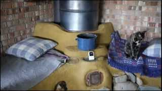 getlinkyoutube.com-Living with the Rocket Mass Heater Part 1, cleaning, lighting, splitting fuel