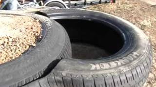 getlinkyoutube.com-Earthship Construction, Half Tires for blocks