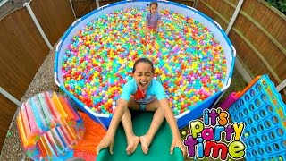 getlinkyoutube.com-Giant Ball Pit Pool Party - Outdoor Playground Fun - Giant Water Slide | Toys AndMe
