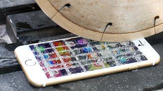 getlinkyoutube.com-Can an iPhone 6S Survive a Diamond Blade?