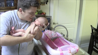getlinkyoutube.com-Baby Aubrey poops on Daddy (and Mommy just laughs)