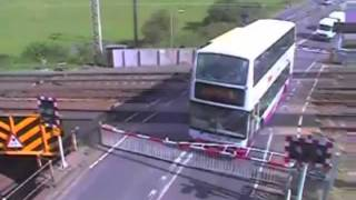 getlinkyoutube.com-Horrifying moment school bus driver gets his double-decker trapped on a level crossing as train CCTV