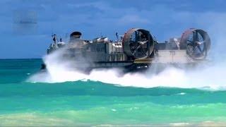 getlinkyoutube.com-US Navy LCAC Hovercraft Land on Beach, Unload Equipment, Return to Aircraft Carrier