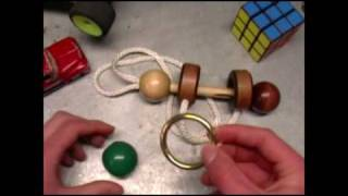 getlinkyoutube.com-Solving The Wood/String puzzle