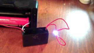 getlinkyoutube.com-High voltage generator 7000 Volts. Chinese module. 18650, 3.7V, spark, lightning 10mm. RUS