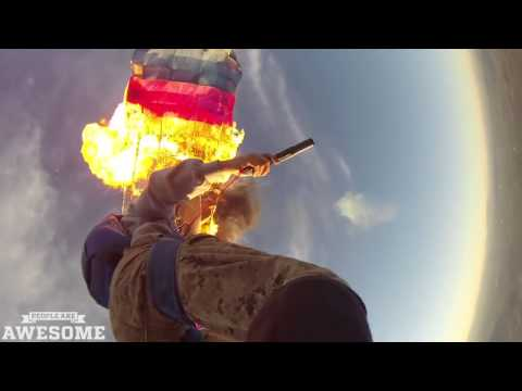 Setting fire to a parachute in mid air! People are Awesome